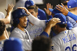 Kansas City Royals' Adalberto Mondesi, left, celebrates in the dugout after his two-run home run off Chicago White Sox starting pitcher Reynaldo Lopez, during the third inning of a baseball game Wednesday, Sept. 11, 2019, in Chicago. (AP Photo/Charles Rex Arbogast)
