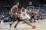 Davidson guard KiShawn Pritchett (20) drives to the basket against Saint Joseph's forward Charlie Brown Jr. (2) during the first half of an NCAA college basketball game in the Atlantic 10 Conference tournament, Friday, March 15, 2019, in New York. (AP Photo/Mary Altaffer)