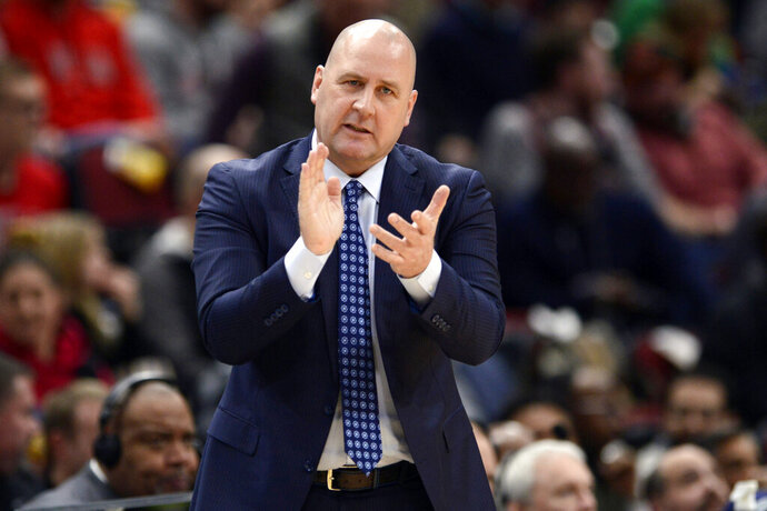 FILE - In this March 10, 2020, file photo, Chicago Bulls coach Jim Boylen cheers on players during the first half of the team's NBA basketball game against the Cleveland Cavaliers in Chicago. Boylen's future is the biggest issue hanging over the Bulls, who were left out when the NBA's Board of Governors approved a 22-team format to restart the pandemic-interrupted season next month in Orlando. (AP Photo/Paul Beaty, File)