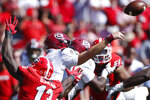 South Carolina quarterback Ryan Hilinski (3) gets the ball away to avoid a sack from Georgia outside linebacker Azeez Ojulari (13) in the first half of a NCAA football game between Georgia and South Carolina in Athens, Ga., on Saturday, Oct. 12, 2019. (Joshua L. Jones/Athens Banner-Herald via AP)