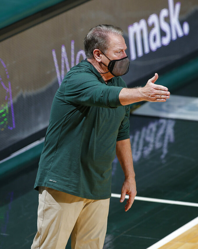 Michigan State coach Tom Izzo gestures during the second half of the team's NCAA college basketball game against Notre Dame, Saturday, Nov. 28, 2020, in East Lansing, Mich. Michigan State won 80-70. (AP Photo/Al Goldis)