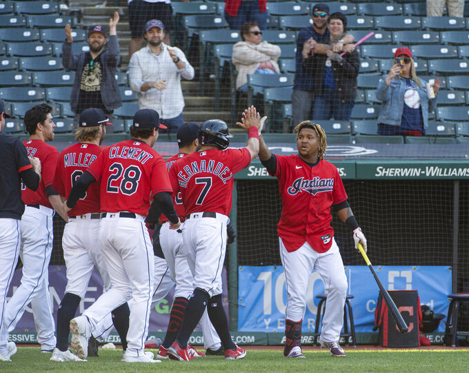 Cleveland Indians' Jose Ramirez, right, celebrates with his teammates after hitting a game winning sacrifice fly off Toronto Blue Jays relief pitcher Anthony Castro in the bottom of the seventh inning of the second baseball game of a doubleheader in Cleveland, Sunday, May 30, 2021. (AP Photo/Phil Long)
