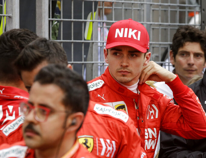 Ferrari driver Charles Leclerc of Monaco watches from outside after he went out of the Monaco Formula One Grand Prix race, at the Monaco racetrack, in Monaco, Sunday, May 26, 2019. (AP Photo/Luca Bruno)