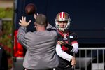 San Francisco 49ers quarterback Nick Mullens warms up during NFL football practice near State Farm Stadium, home of the Arizona Cardinals, Thursday, Dec. 3, 2020, in Glendale, Ariz. The 49ers start a three-week road trip after being forced from their stadium and practice facility because of strict new COVID-19 protocols in their home county in Northern California. (AP Photo/Ross D. Franklin)