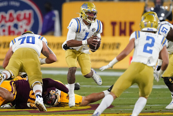 UCLA quarterback Dorian Thompson-Robinson (1) scrambles during the first half of the team's NCAA college football game against Arizona State, Saturday, Dec. 5, 2020, in Tempe, Ariz. (AP Photo/Matt York)