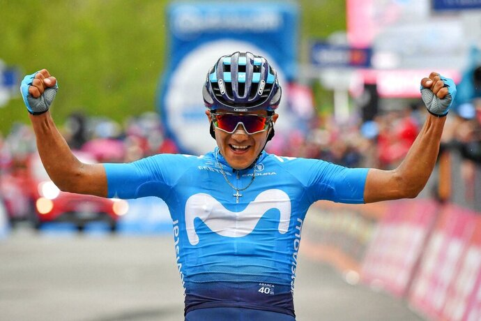 Richard Carapaz celebrates as he crosses the finish line to win the 14th stage of the Giro d'Italia cycling race, from Saint-Vincent to Courmayeur, Saturday, May 25, 2019. Richard Carapaz of Ecuador won the grueling 14th stage of the Giro d'Italia on Saturday to move into the overall lead. (Alessandro Di Meo/ANSA via AP)