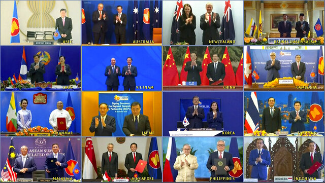 This image made from a teleconference provided by the Vietnam News Agency (VNA) shows the leaders and trade ministers of 15 Regional Comprehensive Economic Partnership (RCEP) countries pose for a virtual group photo in Hanoi, Vietnam on Sunday, Nov. 15, 2020. China and 14 other countries have agreed to set up the world's largest trading bloc, encompassing nearly a third of all economic activity, in a deal many in Asia are hoping will help hasten a recovery from the shocks of the pandemic. (VNA via AP)