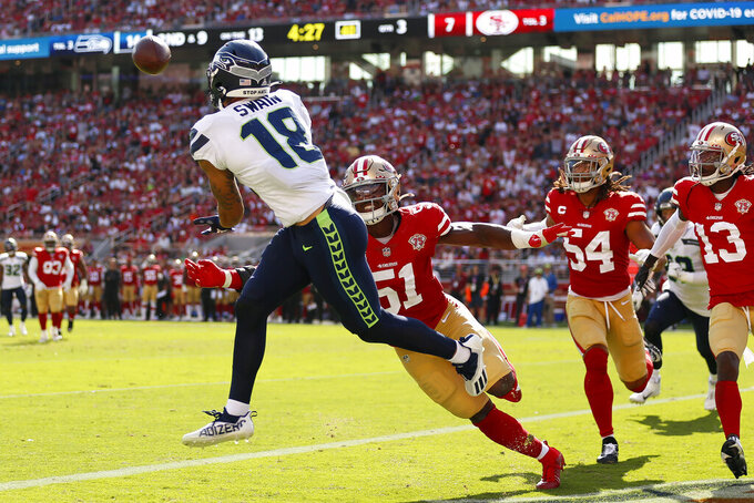 Seattle Seahawks wide receiver Freddie Swain (18) catches a touchdown pass against San Francisco 49ers linebacker Azeez Al-Shaair (51) during the second half of an NFL football game in Santa Clara, Calif., Sunday, Oct. 3, 2021. (AP Photo/Jed Jacobsohn)