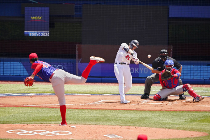 United States' Triston Casas (26) hits a home run off Dominican Republic's Denyi Reyes in the first inning of a baseball game at the 2020 Summer Olympics, Wednesday, Aug. 4, 2021, in Yokohama, Japan. (AP Photo/Sue Ogrocki)