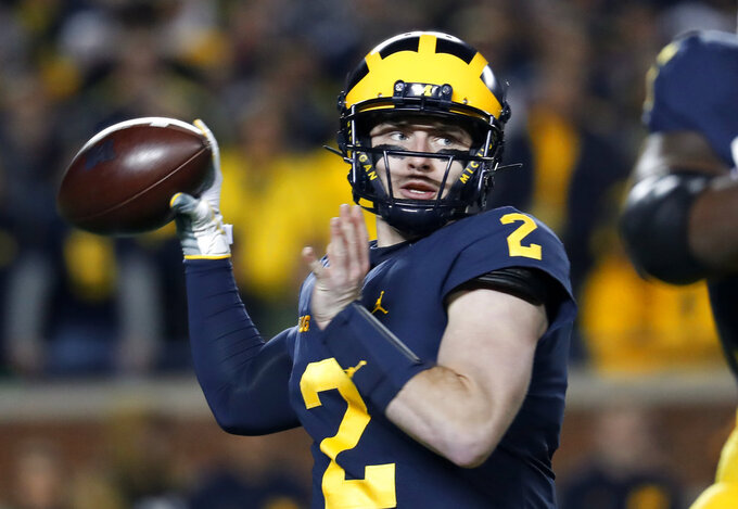 FILE - In this Saturday, Oct. 13, 2018 file photo, Michigan quarterback Shea Patterson throws during the first half of the team's NCAA football game against Wisconsin in Ann Arbor, Mich. No. 4 Michigan (10-1, 8-0, No. 4 CFP) likely will make its first trip to the College Football Playoff by beating Ohio State and then taking care of Northwestern in the Big Ten Championship.(AP Photo/Paul Sancya, File)