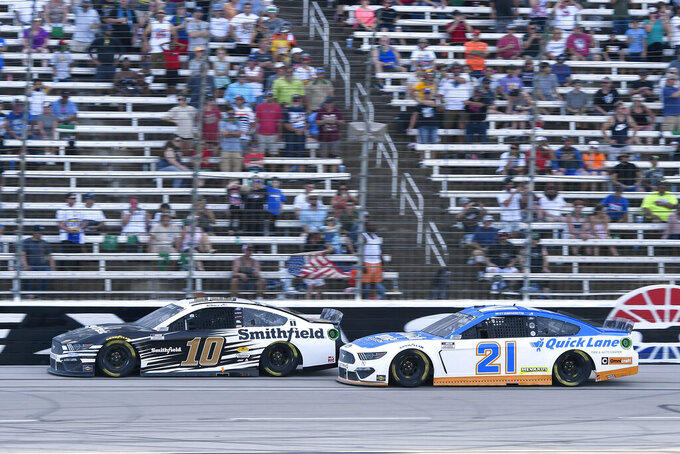 Aric Almirola (10) and Matt DiBenedetto (21) head down the front stretch during the NASCAR All-Star Open Cup Series auto race at Texas Motor Speedway in Fort Worth, Texas, Sunday, June 13, 2021. (AP Photo/Larry Papke)