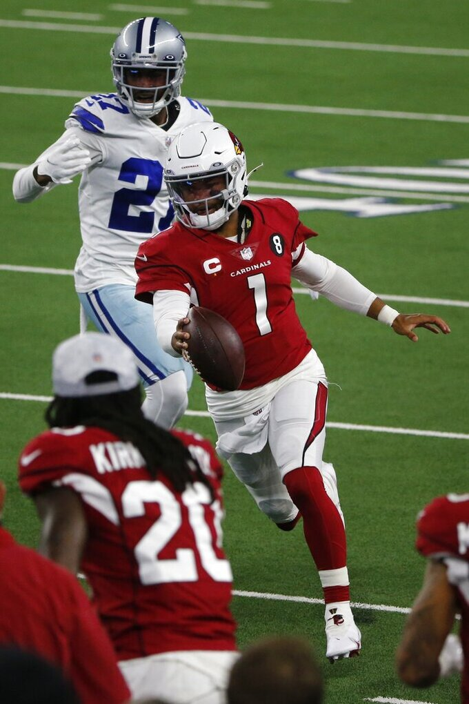 Arizona Cardinals' Kyler Murray (1) heads to the sideline as he carries the ball under pressure from Dallas Cowboys cornerback Trevon Diggs (27) in the first half of an NFL football game in Arlington, Texas, Monday, Oct. 19, 2020. (AP Photo/Michael Ainsworth)