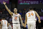 Virginia Tech's Ahmed Hill (13) reacts as he congratulates Kerry Blackshear Jr. (24) after a basket against Miami during the first half of an NCAA college basketball game in the Atlantic Coast Conference tournament in Charlotte, N.C., Wednesday, March 13, 2019. (AP Photo/Chuck Burton)