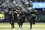 New York Jets cornerback Nate Hairston (21) reacts with teammates after intercepting a pass intended for Miami Dolphins wide receiver Allen Hurns (17) during the first half of an NFL football game, Sunday, Dec. 8, 2019, in East Rutherford, N.J. (AP Photo/Adam Hunger)