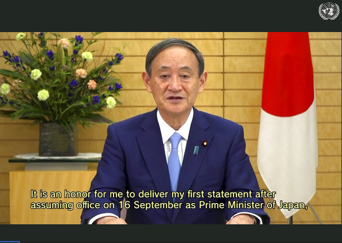 In this photo made from UNTV video, Suga Yoshihide, Prime Minister of Japan, speaks in a pre-recorded message which was played during the 75th session of the United Nations General Assembly, Wednesday, Sept. 23, 2020, at UN Headquarters. (UNTV Via AP )