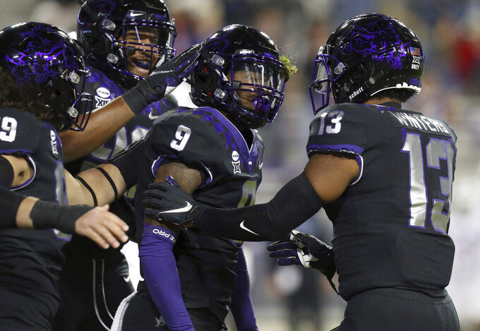 TCU cornerback C.J. Ceasar II (9) celebrates his interception against Louisiana Tech with Dee Winters (13) in the first half during an NCAA college football game, Saturday, Dec. 12, 2020. (AP Photo/Richard W. Rodriguez)