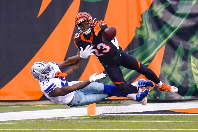 Cincinnati Bengals cornerback Darius Phillips (23) breaks up a pass to Dallas Cowboys wide receiver Michael Gallup (13) in the second half of an NFL football game in Cincinnati, Sunday, Dec. 13, 2020. (AP Photo/Bryan Woolston)