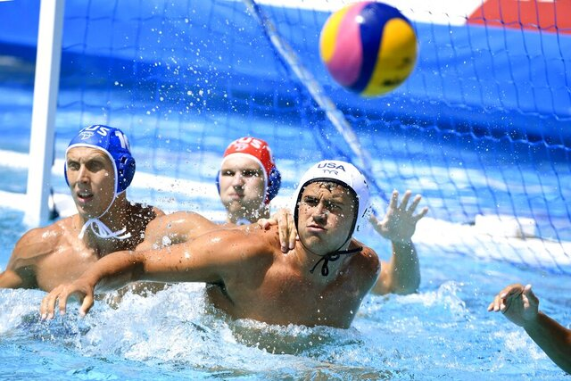 Ben Hallock, right, of the U.S. and Dmitrii Kholod of Russia fight for the ball during the men's water polo Group D third round match of the 17th FINA Swimming World Championships in Hajos Alfred National Swimming Pool in Budapest, Hungary, in this Friday, July 21, 2017, file photo. Hallock, 23, is among 18 U.S. men's water polo players who joined professional teams in Europe after COVID-19 hampered their training in California. (Szilard Koszticsak/MTI via AP, File)