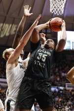 Chicago State center Solomon Hunt (35) shoots over Purdue forward Evan Boudreaux (12) during the first half of an NCAA college basketball game in West Lafayette, Ind., Saturday, Nov. 16, 2019. (AP Photo/Michael Conroy)