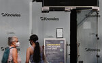 Two women stand outside a closed branch of a shoe shop in Kensington, London, Wednesday, Aug. 12, 2020. The British economy is on course to record the deepest coronavirus-related slump among the world's seven leading industrial economies after official figures showed it shrinking by a 20.4% in the second quarter of 2020 alone said The Office for National Statistics. (AP Photo/Alastair Grant)