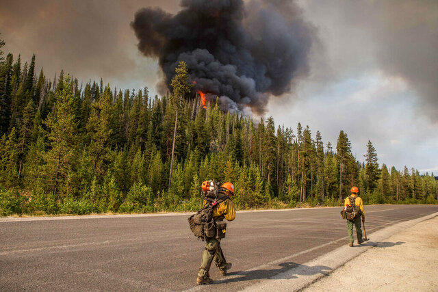 FILE - In this Wednesday, Aug. 7, 2019, file photo released by the U.S. Forest Service smoke from the Nethker Fire billows into the air at Payette National Forest near McCall, Idaho. A giant Idaho forest project favored by some environmental groups but decried by others is on hold again following a federal court ruling. The decision Tuesday, Aug. 11, 2020, halts for the second time a 125-square-mile project on the Payette National Forest that includes commercial timber sales, work to improve fish passage, prescribed burning, the closing of some roads and restoration of Ponderosa pine ecosystems. (U.S. Forest Service via AP,File)