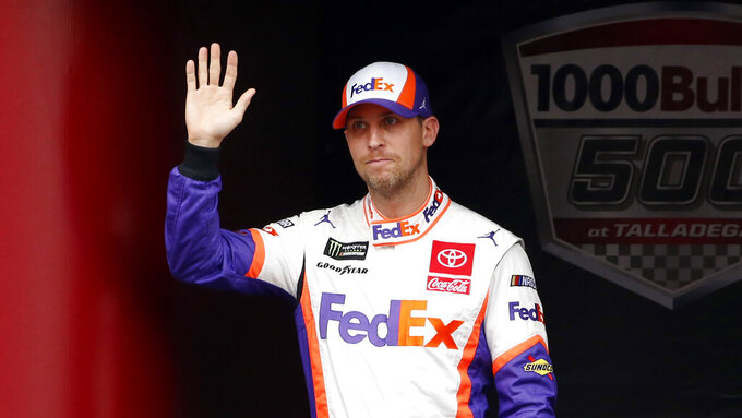 Monster Energy NASCAR Cup Series driver Denny Hamlin (11) waves at driver introductions during a NASCAR Cup Series auto race at Talladega Superspeedway, Sunday, Oct. 14, 2019, in Talladega, Ala. (AP Photo/Butch Dill)