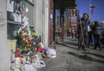 REMOVES REFERENCE TO HOMELESS KILLED  - A makeshift memorial stands at the site for Chuen Kok Friday Oct. 18, 2019, in New York.  Kok, an 83-year-old homeless man whom Chinatown residents warmly greeted as