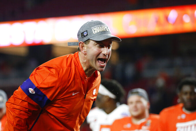 Clemson coach Dabo Swinney celebrates after Clemson defeated Ohio State 29-23 in the Fiesta Bowl NCAA college football playoff semifinal Saturday, Dec. 28, 2019, in Glendale, Ariz. (AP Photo/Ross D. Franklin)