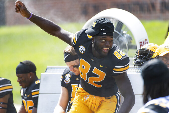 Missouri tight end Daniel Parker Jr. laughs with teammates late in the fourth quarter of an NCAA college football game against Southeast Missouri State, Saturday, Sept. 18, 2021, in Columbia, Mo. Missouri won 59-28. (AP Photo/L.G. Patterson)