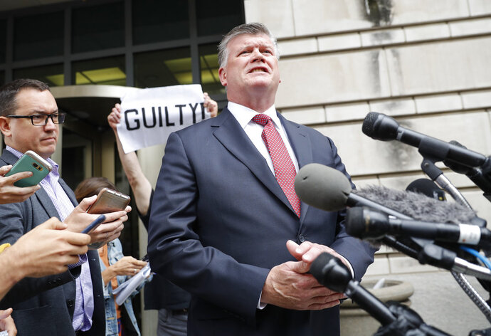 Attorney Kevin Downing, with the defense team for Paul Manafort, speaks to members of the media after leaving federal court in Washington, Friday, Sept. 14, 2018. Former Trump campaign chairman Paul Manafort has pleaded guilty to two federal charges as part of a cooperation deal with prosecutors. The deal requires him to cooperate