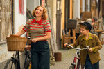 This image released by Fox Searchlight Pictures shows Scarlett Johansson, left, and Roman Griffin Davis in a scene from the WWII satirical film