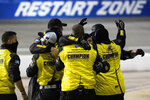 The pit crew for Grant Enfinger celebrate after winning a NASCAR Truck Series auto race Thursday, Sept. 10, 2020, in Richmond, Va. (AP Photo/Steve Helber)