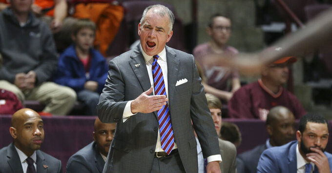Virginia Tech head coach Mike Young encourages his team in the first half of an NCAA college basketball game against Maryland-Eastern Shore in Blacksburg, Va., Sunday, Dec. 29 2019. (Matt Gentry/The Roanoke Times via AP)