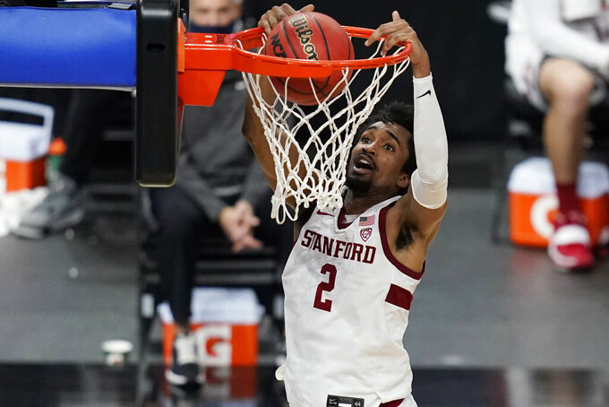 Stanford's Bryce Wills (2) dunks against California during the second half of an NCAA college basketball game in the first round of the Pac-12 men's tournament Wednesday, March 10, 2021, in Las Vegas. (AP Photo/John Locher)