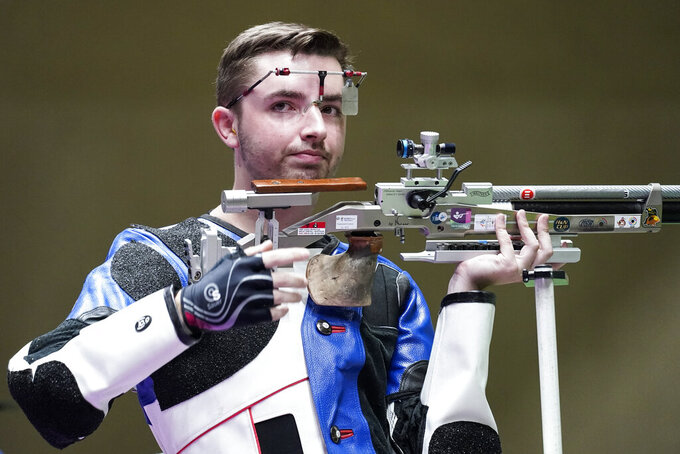 William Shaner, of the United States, reacts after winning the gold medal in the men's 10-meter air rifle at the Asaka Shooting Range in the 2020 Summer Olympics, Sunday, July 25, 2021, in Tokyo, Japan. (AP Photo/Alex Brandon)