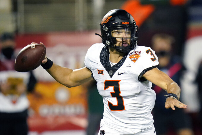 Oklahoma State quarterback Spencer Sanders (3) throws a pass against Miami during the second half of the Cheez-it Bowl NCAA college football game, Tuesday, Dec. 29, 2020, in Orlando, Fla. (AP Photo/John Raoux)