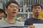 FILE - In this June 18, 2019, file photo, pro-democracy activists Nathan Law, left, and  Joshua Wong speak to the media outside government office in Hong Kong. Prominent Hong Kong democracy activist Nathan Law has left the city for an undisclosed location, he revealed on his Facebook page shortly after testifying at a U.S. congressional hearing about the tough national security law China had imposed on the semi-autonomous territory.  In his post late Thursday, July 2, 2020, he said that he decided to take on the responsibility for advocating for Hong Kong internationally and had since left the city. (AP Photo/Kin Cheung, File)