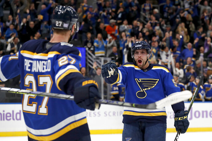 St. Louis Blues' David Perron, right, is congratulated by Alex Pietrangelo (27) after scoring in overtime of the team's NHL hockey game against the Columbus Blue Jackets on Friday, Nov. 1, 2019, in St. Louis. The Blues won 4-3. (AP Photo/Jeff Roberson)