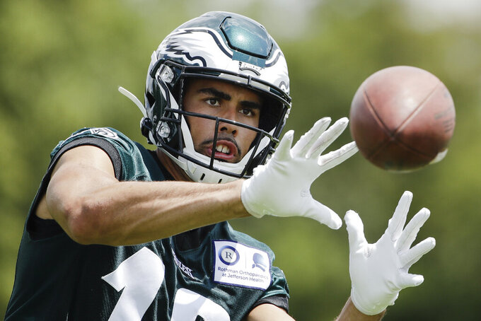 FILE - In this July 25, 2019, file photo, Philadelphia Eagles wide receiver J.J. Arcega-Whiteside catches a pass at the NFL football team's training camp in Philadelphia. Arcega-Whiteside became the first player born in Spain drafted in the NFL when the Philadelphia Eagles selected him with the 57th overall pick in the second round in April. (AP Photo/Matt Rourke, File)