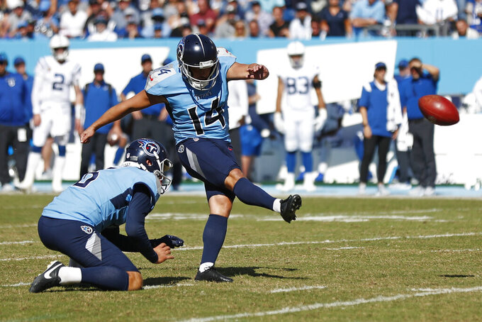 Tennessee Titans kicker Randy Bullock (14) kicks a 32-yard field goal against the Indianapolis Colts in the second half of an NFL football game Sunday, Sept. 26, 2021, in Nashville, Tenn. (AP Photo/Wade Payne)
