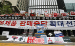 South Korean small and medium-sized business owners stage a rally calling for a boycott of Japanese products in front of the Japanese embassy in Seoul, South Korea, Monday, July 15, 2019. South Korea and Japan last Friday, July 12, failed to immediately resolve their dispute over Japanese export restrictions that could hurt South Korean technology companies, as Seoul called for an investigation by the United Nations or another international body. The signs read: