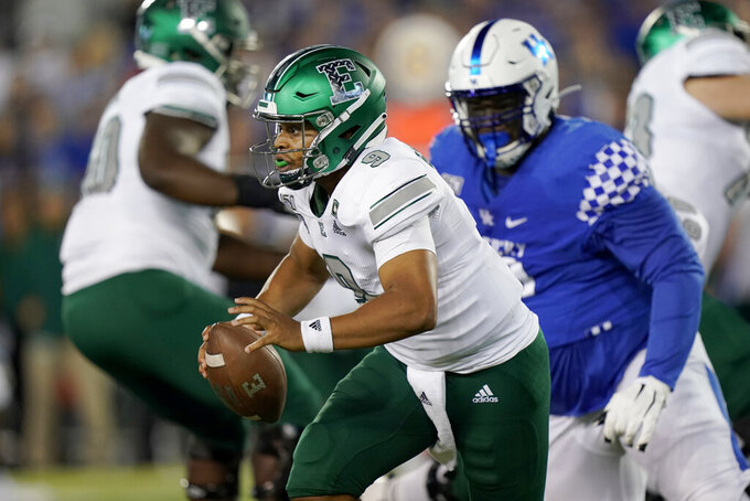 Eastern Michigan quarterback Mike Glass III (9) scrambles with the ball during the first half of an NCAA college football game against Kentucky, Saturday, Sept. 7, 2019, in Lexington, Ky. (AP Photo/Bryan Woolston)