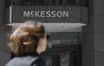 FILE - In this July 17, 2019 file photo, a pedestrian passes a McKesson sign on an office building in San Francisco. Negotiations aimed at reaching a major settlement in the nation's opioid litigation reached an impasse Friday, Oct. 18, 2019. Key differences were between state attorneys general and lawyers representing local governments, rather than with the drugmakers and distributors, including McKesson, they are suing. (AP Photo/Jeff Chiu, File)
