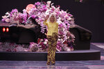 Designer Donatella Versace accepts applause at the end of the Versace men's Spring-Summer 2020 collection, unveiled during the fashion week, in Milan, Italy, Saturday, June 15, 2019. (AP Photo/Luca Bruno)