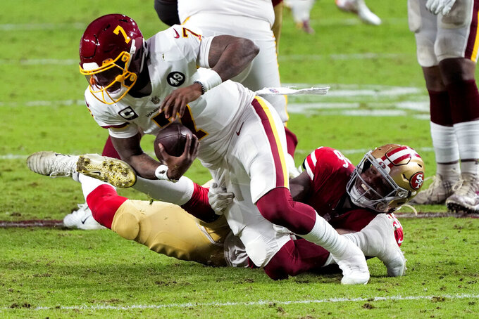 San Francisco 49ers defensive end Dion Jordan sacks Washington Football Team quarterback Dwayne Haskins (7) during the second half of an NFL football game, Sunday, Dec. 13, 2020, in Glendale, Ariz. (AP Photo/Rick Scuteri)