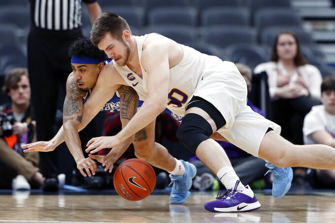 Drake's Roman Penn, left, and Northern Iowa's Austin Phyfe dive after a loose ball during the first half of an NCAA college basketball game in the quarterfinal round of the Missouri Valley Conference men's tournament Friday, March 6, 2020, in St. Louis. (AP Photo/Jeff Roberson)