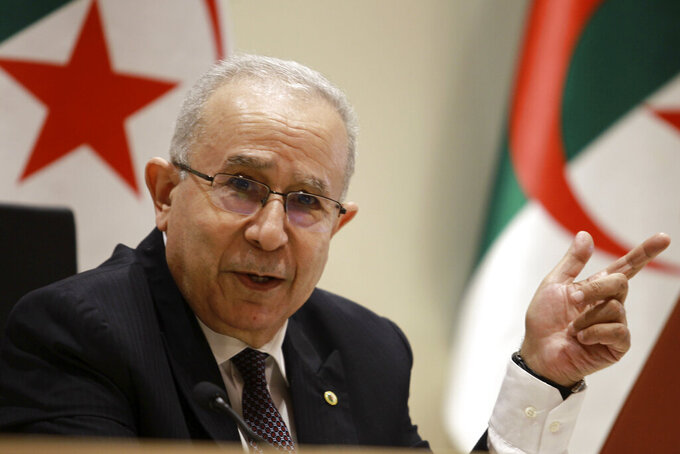 """Algerian Foreign Minister Ramtane Lamamra gestures as he reads a statement from the country's president in Algiers, Tuesday, Aug.24, 2021. Algeria's foreign minister said Tuesday that his country is breaking diplomatic ties with Morocco """"starting today,"""" amid growing hostility between the North African neighbors. (AP Photo/Fateh Guidoum)"""