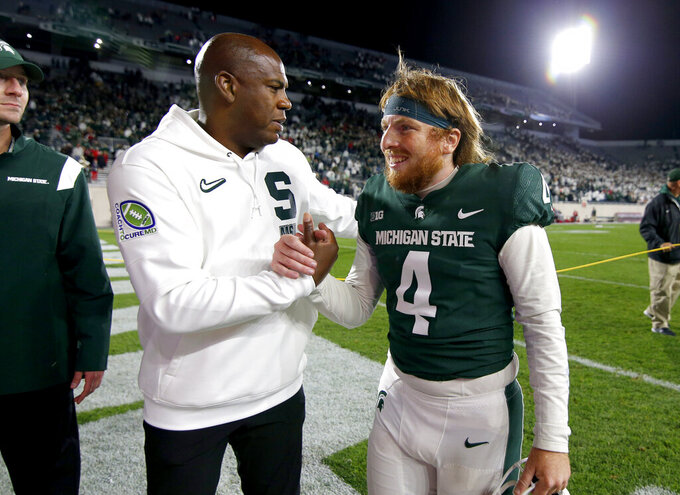 Michigan State coach Mel Tucker, left, congratulates kicker Matt Coghlin (4) after Coghlin kicked the game-winning field goal in overtime against Nebraska in an NCAA college football game, Saturday, Sept. 25, 2021, in East Lansing, Mich. (AP Photo/Al Goldis)