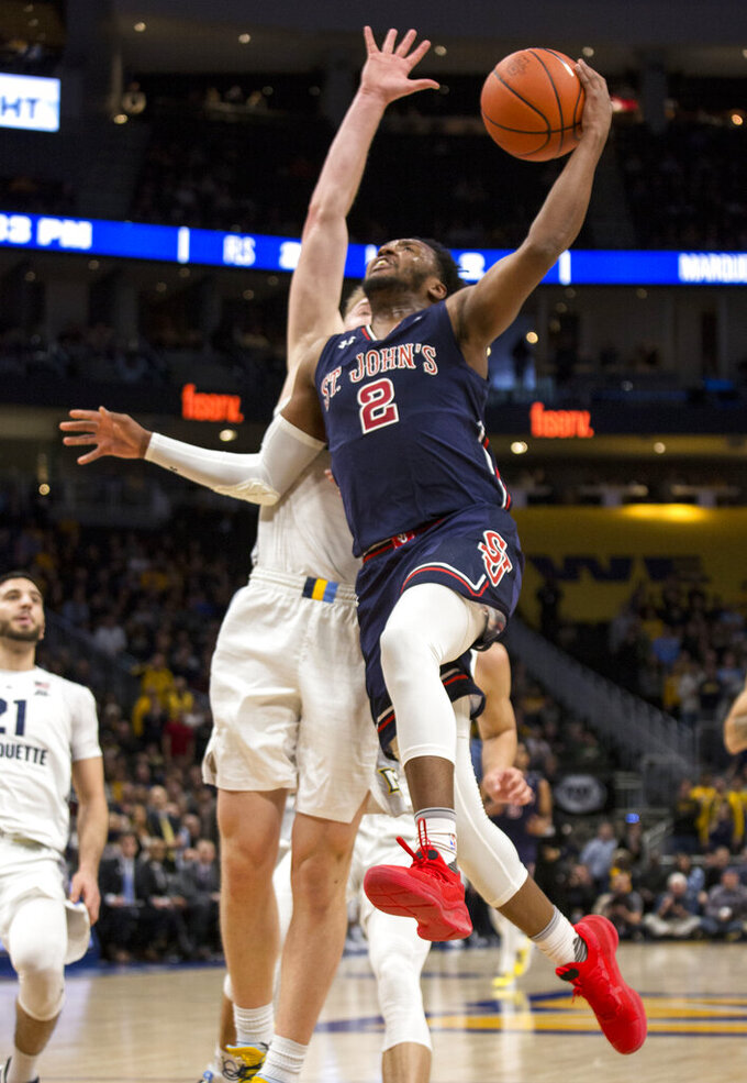 St. John's guard Shamorie Ponds, right, goes up for a basket against Marquette during the second half of an NCAA college basketball game Tuesday, Feb. 5, 2019, in Milwaukee. (AP Photo/Darren Hauck)