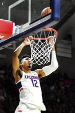 Connecticut's Tyler Polley (12) attempts a dunk but it bounces out in the second half of an NCAA college basketball game against Sacred Heart, Friday, Nov. 8, 2019, in Storrs, Conn. (AP Photo/Stephen Dunn)